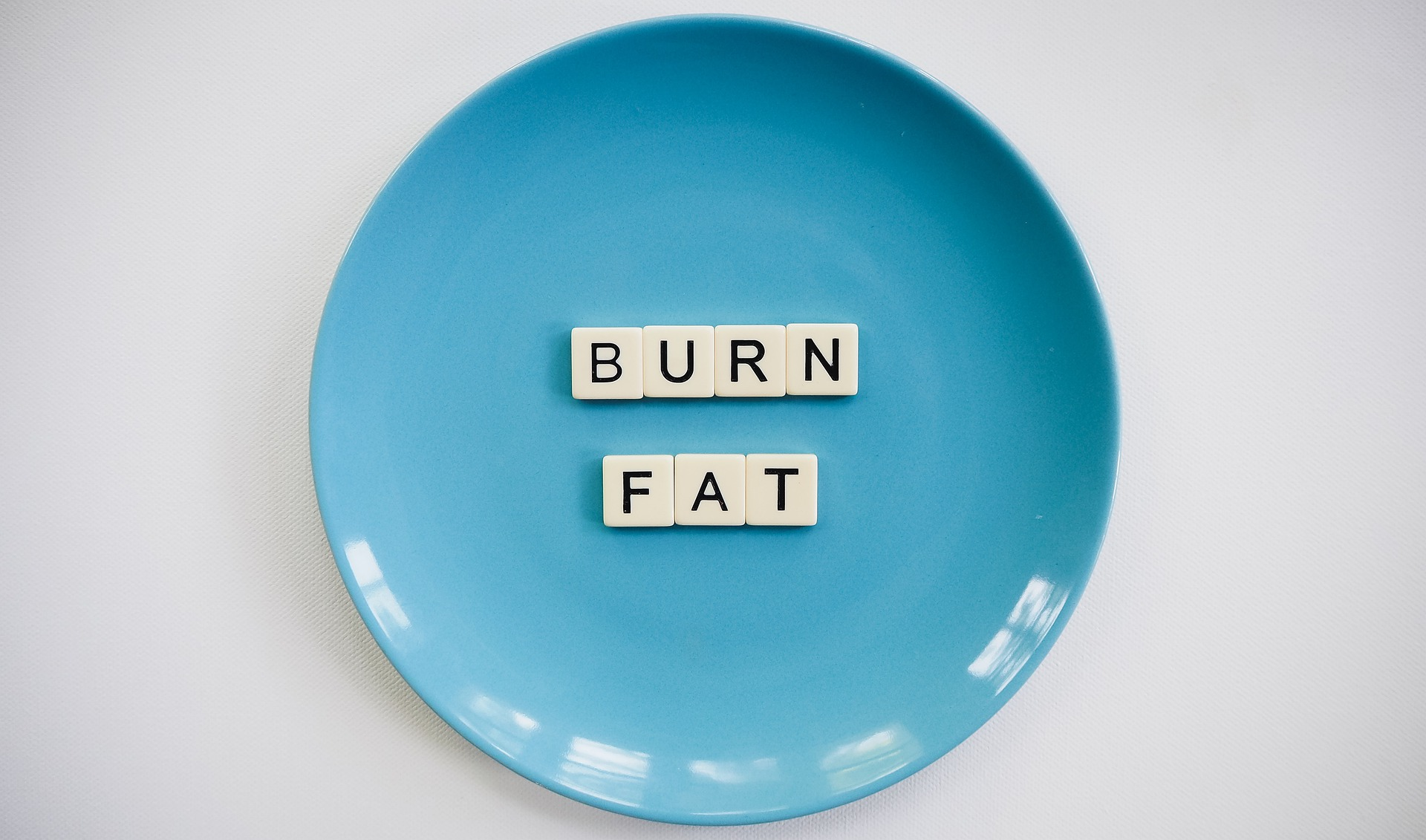 Burn fat lettering on a plate